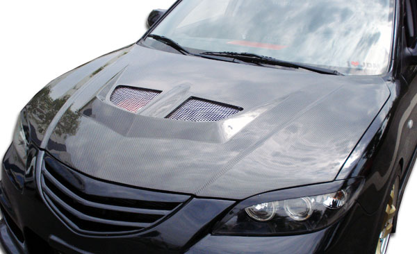 Carbon Creations 104159 | Mazda 3 4DR Carbon Creations EVO Hood 1-Piece; 2004-2009