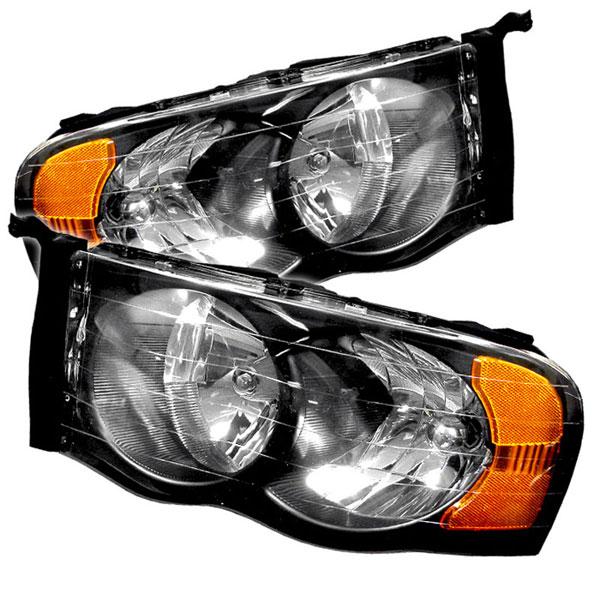 xTune HD-JH-DR02-AM-BK |  Dodge Ram 1500 Amber Crystal Headlights - Black; 2002-2005